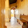 Spanish building details with arches and bench. — Stock Photo