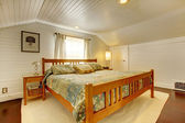 Wood plank paneled bedroom — Stock Photo