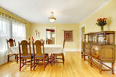 Spacious wood carved dining room — Stock Photo