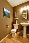 Bathroom corner with toilet and washstand — Stock Photo
