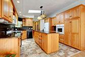 Kitchen furniture set with white appliances — Stock Photo