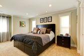 Elegant black bedroom furniture set — Stock Photo