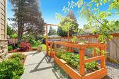 Backyard garden bed with trellis — Stock Photo