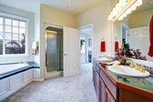 Luxury bathroom with door to master bedroom — Stock Photo