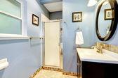 Light blue bathroom with tile trim — Foto Stock