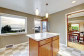 View of kitchen island and open door — Stock Photo