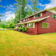 Red clapboard siding house with garage — Stock Photo #44705715