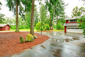 View of garage and wet driveway. — Stock Photo