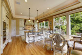 Luxury kitchen room with dining table — Fotografia Stock