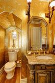 Antique style gold bathroom — Stock Photo