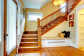 Hallway interior. Old staircase with bench — Stock Photo