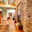 Luxury house interior. Stone wall with fireplace — Stock Photo