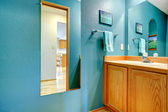 Bathroom turquoise wall with mirror — Stock Photo