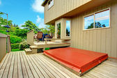Backyard deck with patio area and jacuzzi — Stock Photo