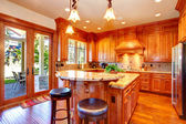 Gold kitchen room with island — Stock Photo