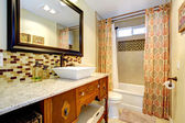Bathroom with antique cabinets — Stock Photo