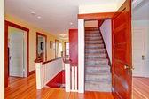 Hallway with open door to upstairs — Stockfoto