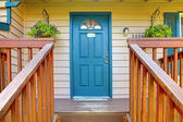 Entrance porch with blue door — Stock Photo