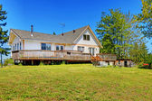 Old farm house with walkout deck. Backyard view — Stockfoto