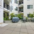 Residential building. Patio area with swimming pool — Stock Photo #47390899