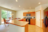 Kitchen room with dining area — Stock Photo