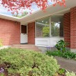 Brick house with entrance porch view — Stock Photo #47724501