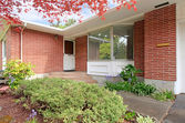 Brick house with entrance porch view — Stock Photo