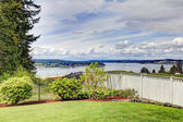 Fenced backyard with water view — Stock Photo