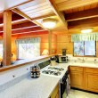 Kitchen interior in log cabin house — Stock Photo