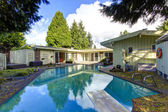 Backyard with swimming pool — Stock Photo