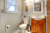 Bathroom interior with new vanity cabinet and mirror — Stock Photo