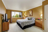Bedroom inteior in mustard color — Stock Photo