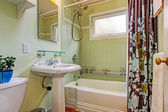 Mint bathroom with tile wall trim — Stock Photo