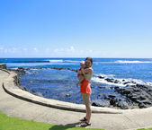 Mother and her baby on the ocean. Kauai trip — Stock Photo