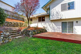 House backyard view. Wooden floor walkout deck — Stock Photo