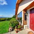 Modern house entrance porch with red door — Stock Photo #49903011