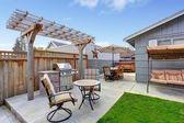 House backyard with patio area — Stock Photo