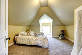 Soft ivory bedroom with vaulted ceiling — Stock Photo