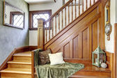 Wooden staircase with bench in old house — Stock Photo