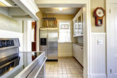 Kitchen interior in old house with modern appliances — Stock Photo