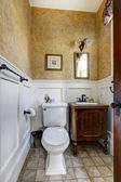 Small bathroom interior with antique vanity cabinet — Stock Photo