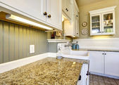 White kitchen cabinets with granite tops — Stock Photo