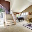 House interior with open floor plan. Living room with staircase — Stock Photo