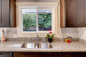 Kitchen cabinet with sink and window view — Stock Photo