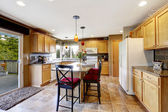 Bright kitchen room interior with walkout deck  — Stock Photo