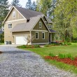 Countryside house exterior. View of entrance and gravel driveway — Stock Photo #50019783