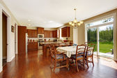 Spacious kitchen room with dining area and walkout deck — Photo