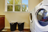 Bright ivory laundry room — Stock Photo