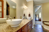 Modern bathroom vanity cabinet with vessel sinks — Stock Photo