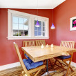 Bright red dining area with rustic table set — Stock Photo #50098183